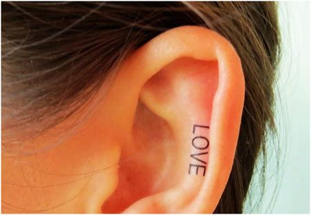 Top 10 des conceptions de tatouage de l'oreille Photo